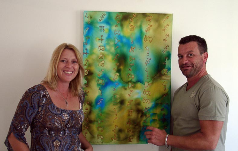 "Janine Miller and Adrian Shafran with ""Starcode Message No. 7"", one of the 2 works by Angela which Adrian purchased"