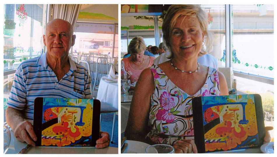 Reg and Sue Payne with Angela Dicker's placemats at The Jolly Frog Restaurant
